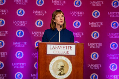 Alison Byerly speaks at podium at presidential announcement