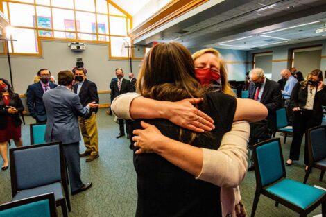 Hannah Tatu hugs Nicole Hurd