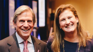 Nicole Hurd and Peter Grauer smile