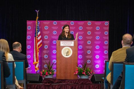 Nicole Hurd speaks at podium in Marlo Room