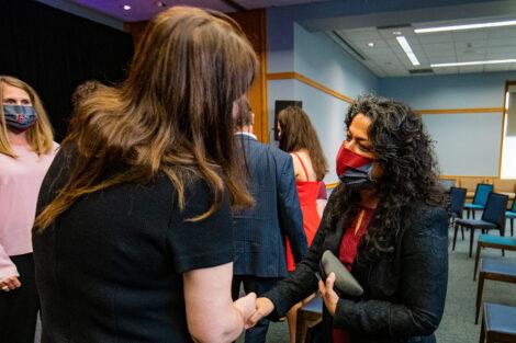 Nicole Hurd shakes Jamila Bookwala's hand