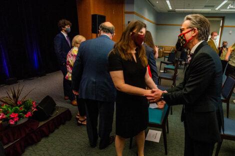 Nicole Hurd shakes John O'Keefe's hand