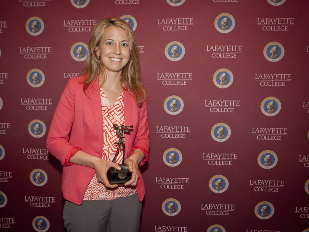 Amber Zuber holds her 2016 Administrator of the Year Award.